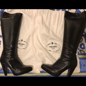 Black genuine leather Prada knee high boots